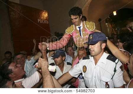 Spanish Bullfighter Jose Tomas going out to shoulders for the big door after one having big bullfigh