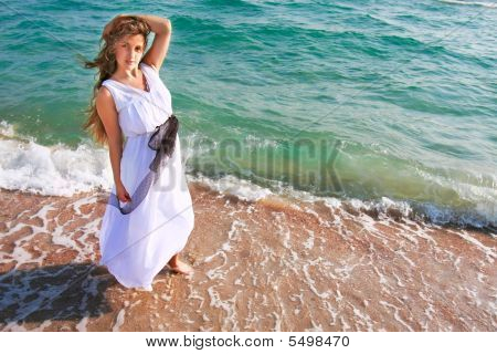 Attractive Girl In White Dress On Sea Background
