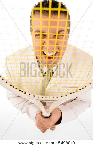 Manager Looking Through Racket