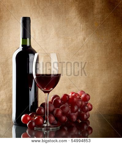 Bottle Of Wine And A Bunch Of Red Grapes