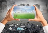 stock photo of cloudy  - Concept of sustainable development with green vision in a tablet - JPG