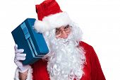 picture of guess  - santa claus si listening to a gift box trying to guess what it is - JPG