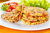 stock photo of chives  - fresh homemade vegetable fritters with zucchini paprika and corn - JPG