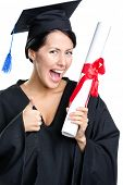 stock photo of school-leaver  - Graduating student with the diploma and in the black academic gown thumbs up - JPG