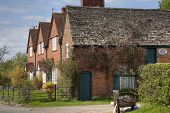 pic of english cottage garden  - Row of brick cottages - JPG
