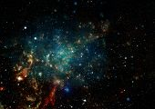 stock photo of outer  - Small part of an infinite star field of space in the Universe - JPG