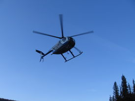 picture of hughes  - Hughes 500 helicopter from below while it is flying - JPG