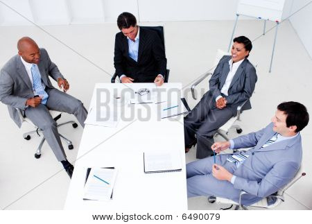 High Angle Of A Smiling Business Team In A Meeting