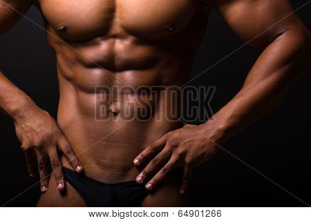 closeup of muscular african man 6 packs