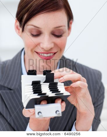 Portrait Of A Businesswoman Searching For The Index