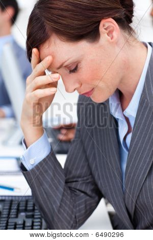 Attractive Businesswoman Suffering From A Migraine