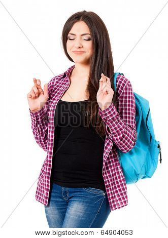 Student girl making a wish isolated on white background