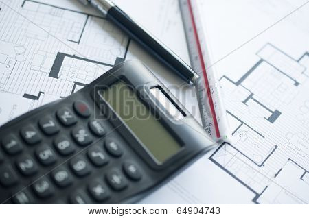 Architect with calculator and plan, pencil and ruler