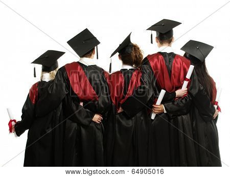 Group of graduated young students in black mantles