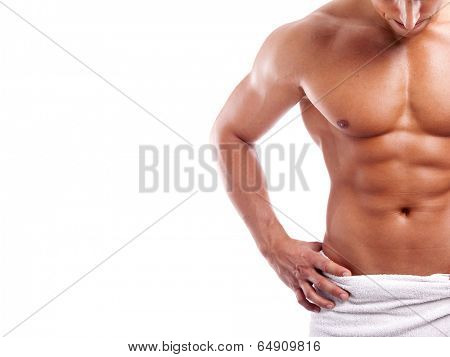 Muscular man in towel, isolated on white background