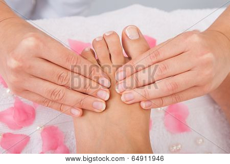 Woman's Feet Receiving Foot Massage