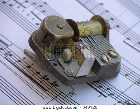 Music Box Over Sheet Music