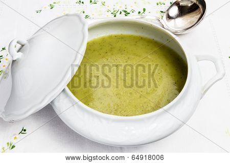 Vegetable Soup In White Porcelain Tureen With Silver Ladle