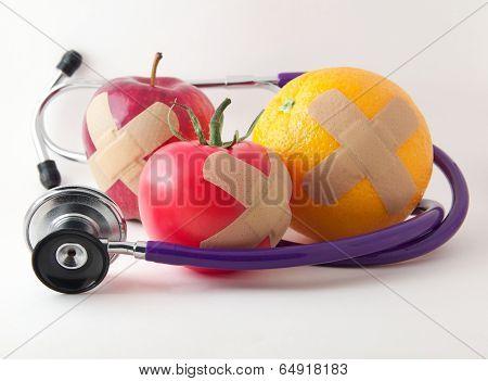 Bandaged Apple Tomato and Orange with Stethescope
