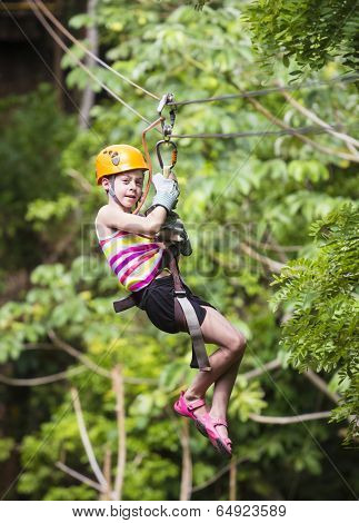 Young girl on a jungle zip line