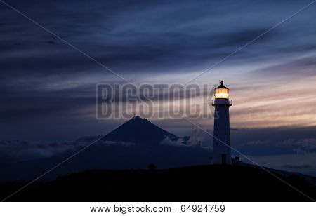 Egmont lighthouse and Taranaki Mount on background, New Zealand