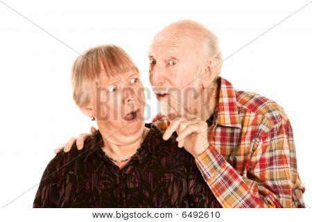 Man Talking To Shocked Wife
