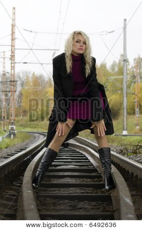 Woman On Railway Tracks