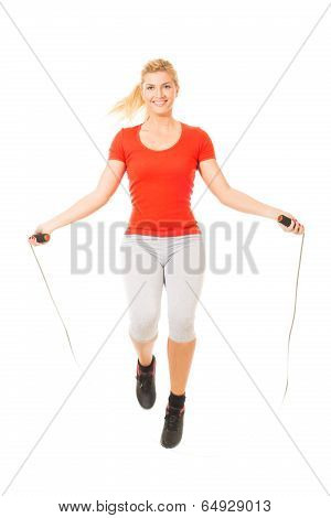 Woman exercising fitness jumping rope in