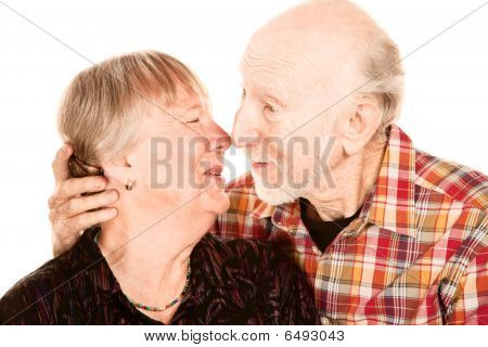 Smiling Senior Couple Touching Noses