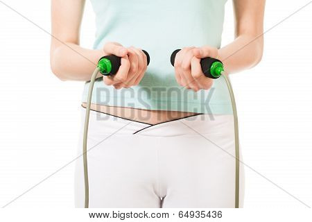Woman holding jumping rope