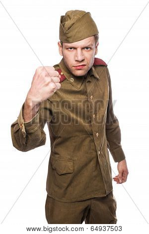 Angry russian soldier threaten with a fist