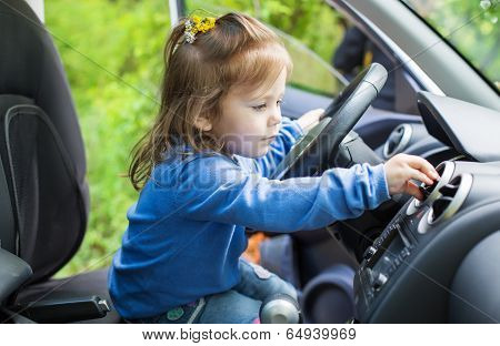 Cute Little Girl Behind Wheel