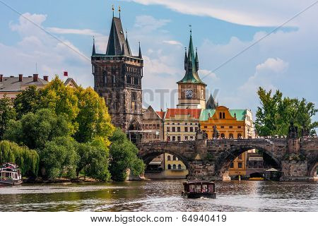 Medieval tower and famous Charles Bridge over Vltava river in Prague, Czech Republic.