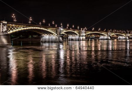 Margaret Bridge Across The Danube River By Night. Budapest, Hungary