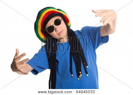 European boy in a cap with artificial dreadlocks sings rap.