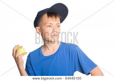 Serious boy holding a tennis ball.