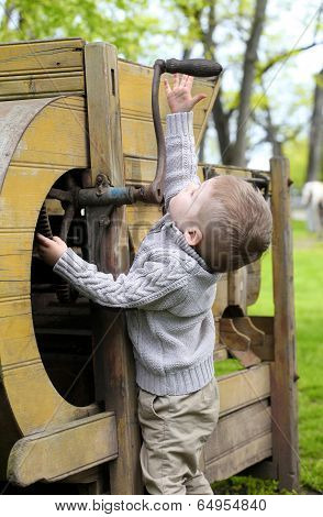 2 Years Old Curious Baby Boy Managing With Old Agricultural Machinery