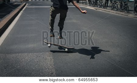 Detail Of A Guy Performing A Trick While Skateboarding