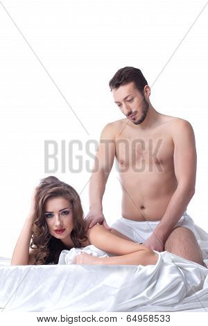 Attractive man doing massage to his mistress