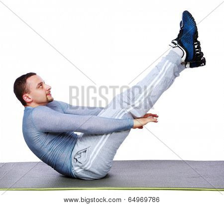 Muscular man exercising on exercise mat over white background