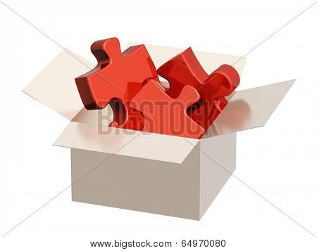 Parts of a puzzle in cardboard box. Isolated on white background