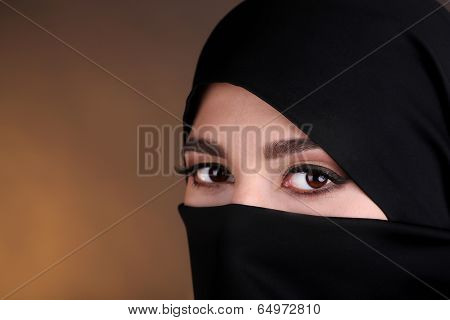 Beautiful muslim arabic woman in paranja on dark color background