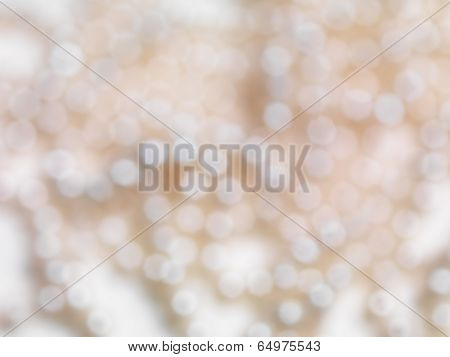 Abstract beige shiny blurred out of focus background texture