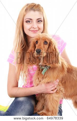 Beautiful young woman with cocker spaniel isolated on white