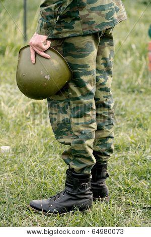 Soldier Holding A Helmet. End Of Hostilities