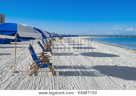 Lots Of Sun Loungers And Beach Umbrellas On Silver Sand,  Vacation Concept