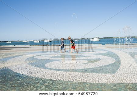 Children in water feature.