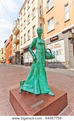 Statue Of Woman Baker (piernikarka) In Torun, Poland