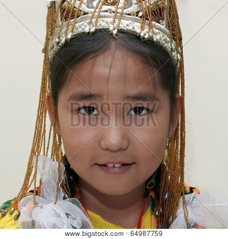 Ashgabat, Turkmenistan - August 4:  An Unidentified Asian Gerl  Looks Up And Smiles. Children's Foru