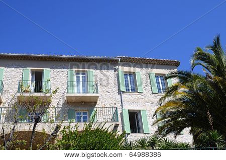 White Building And Green Shutters In Provence, France